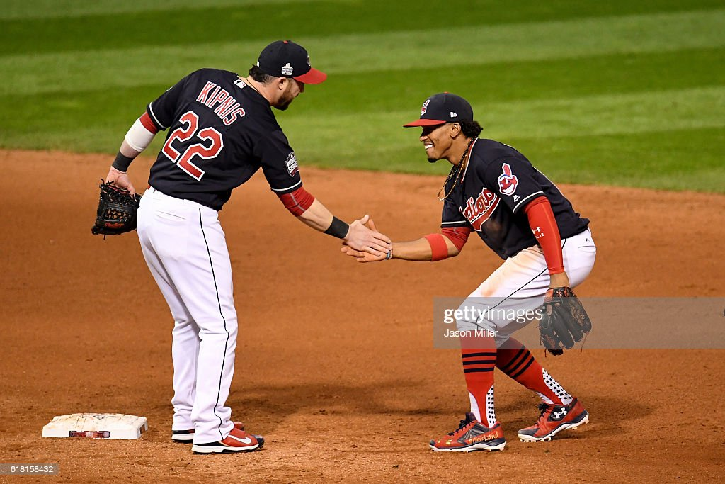 Jason Kipnis #22 of the Cleveland Indians celebrates with Francisco Lindor #12 after defeating the Chicago Cubs 6-0 in Game One of the 2016 World Series at Progressive Field on October 25, 2016 in Cleveland, Ohio.