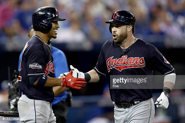 Jason Kipnis of the Cleveland Indians celebrates with his teammate Francisco Lindor after hitting a solo home run in the sixth inning against Marcus...