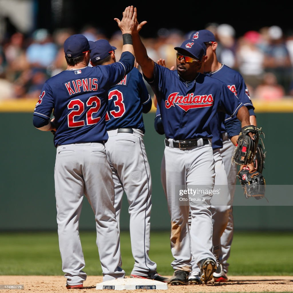 <a gi-track='captionPersonalityLinkClicked' href=/galleries/search?phrase=Jason+Kipnis&family=editorial&specificpeople=5330784 ng-click='$event.stopPropagation()'>Jason Kipnis</a> #22 of the Cleveland Indians celebrates with <a gi-track='captionPersonalityLinkClicked' href=/galleries/search?phrase=Michael+Bourn&family=editorial&specificpeople=835742 ng-click='$event.stopPropagation()'>Michael Bourn</a> #24 after defeating the Seattle Mariners 10-1 at Safeco Field on July 24, 2013 in Seattle, Washington.
