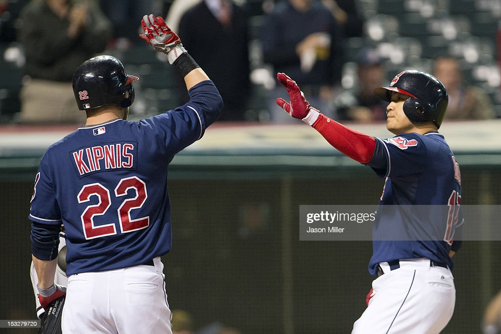 Jason Kipnis #22 of the Cleveland Indians celebrates with Shin-Soo Choo #17 after Choo hit a solo home run during the fourth inning against the Chicago White Sox at Progressive Field on October 2, 2012 in Cleveland, Ohio.