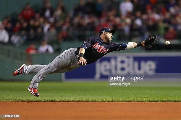 Jason Kipnis of the Cleveland Indians dives for a single hit by Travis Shaw of the Boston Red Sox in the eighth inning during game three of the...