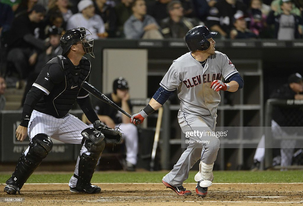 <a gi-track='captionPersonalityLinkClicked' href=/galleries/search?phrase=Jason+Kipnis&family=editorial&specificpeople=5330784 ng-click='$event.stopPropagation()'>Jason Kipnis</a> #22 of the Cleveland Indians (R) follows through on an RBI single scoring teammates Ezequiel Carrera #12 and Lonnie Chisenhall #8 as catcher <a gi-track='captionPersonalityLinkClicked' href=/galleries/search?phrase=A.J.+Pierzynski&family=editorial&specificpeople=204486 ng-click='$event.stopPropagation()'>A.J. Pierzynski</a> #12 of the Chicago White Sox watches the ball during the fourth inning at U.S. Cellular Field on September 26, 2012 in Chicago, Illinois.