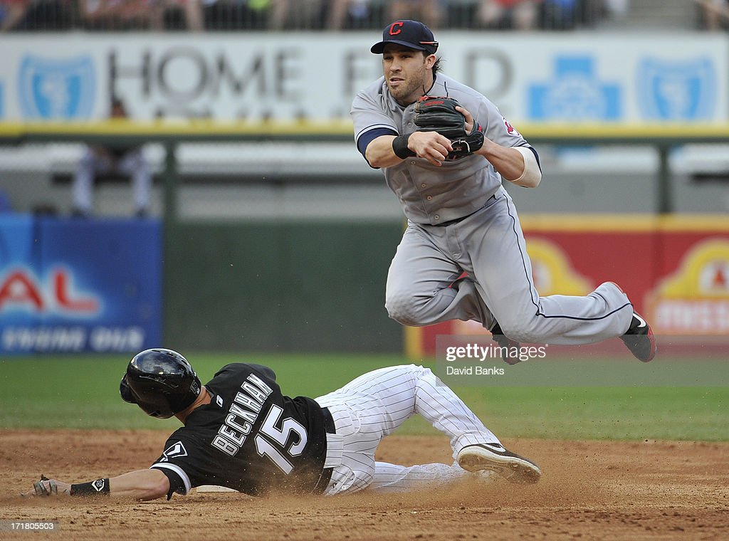<a gi-track='captionPersonalityLinkClicked' href=/galleries/search?phrase=Jason+Kipnis&family=editorial&specificpeople=5330784 ng-click='$event.stopPropagation()'>Jason Kipnis</a> #22 of the Cleveland Indians forces out <a gi-track='captionPersonalityLinkClicked' href=/galleries/search?phrase=Gordon+Beckham&family=editorial&specificpeople=5411079 ng-click='$event.stopPropagation()'>Gordon Beckham</a> #15 of the Chicago White Sox during the third inning in the first game of a doubleheader on June 28, 2013 at U.S. Cellular Field in Chicago, Illinois.