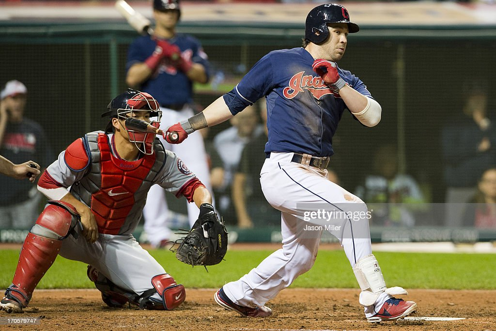 <a gi-track='captionPersonalityLinkClicked' href=/galleries/search?phrase=Jason+Kipnis&family=editorial&specificpeople=5330784 ng-click='$event.stopPropagation()'>Jason Kipnis</a> #22 of the Cleveland Indians grounds into a fielder's choice, scoring Drew Stubbs (not pictured) for the win in the ninth inning against the Washington Nationals at Progressive Field on June 14, 2013 in Cleveland, Ohio. The Indians defeated the Nationals 2-1.