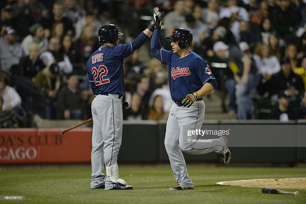 <a gi-track='captionPersonalityLinkClicked' href=/galleries/search?phrase=Jason+Kipnis&family=editorial&specificpeople=5330784 ng-click='$event.stopPropagation()'>Jason Kipnis</a> #22 of the Cleveland Indians (L) high fives <a gi-track='captionPersonalityLinkClicked' href=/galleries/search?phrase=Asdrubal+Cabrera&family=editorial&specificpeople=834042 ng-click='$event.stopPropagation()'>Asdrubal Cabrera</a> #13 after Cabrera scored on an RBI single hit by Nick Swisher #33 during the fifth inning against the Chicago White Sox at U.S. Cellular Field on April 11, 2014 in Chicago, Illinois.
