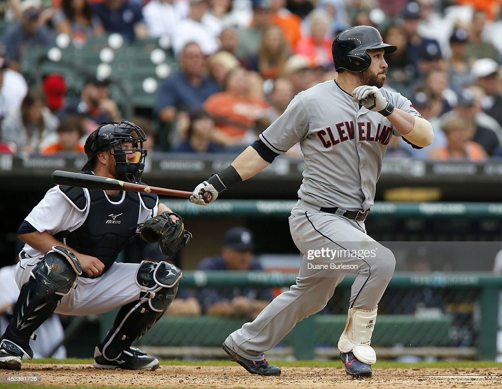 <a gi-track='captionPersonalityLinkClicked' href=/galleries/search?phrase=Jason+Kipnis&family=editorial&specificpeople=5330784 ng-click='$event.stopPropagation()'>Jason Kipnis</a> #22 of the Cleveland Indians hits an RBI-single to drive in Yan Gomes as catcher <a gi-track='captionPersonalityLinkClicked' href=/galleries/search?phrase=Bryan+Holaday&family=editorial&specificpeople=7511226 ng-click='$event.stopPropagation()'>Bryan Holaday</a> #50 of the Detroit Tigers works behind the plate during the seventh inning of game one of a doubleheader at Comerica Park on July 19, 2014 in Detroit, Michigan.