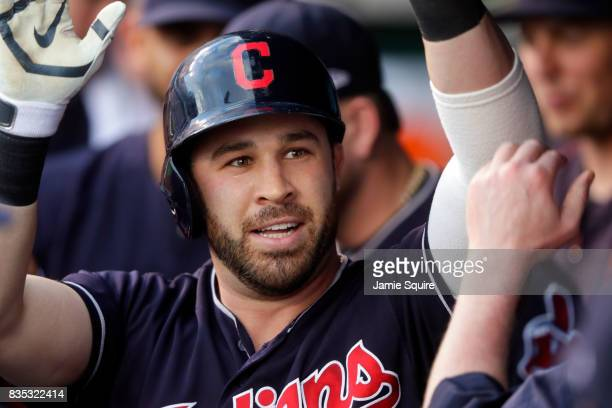 Jason Kipnis of the Cleveland Indians is congratulated by teammates in the dugout after hitting a solo home run during the 1st inning of the game...