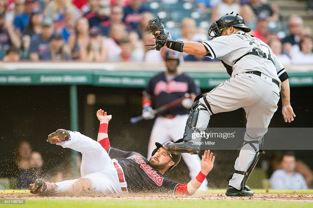 Jason Kipnis of the Cleveland Indians is out at home on the tag from catcher Dioner Navarro of the Chicago White Sox during the second inning at...