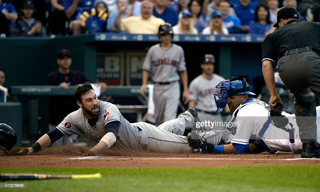 <a gi-track='captionPersonalityLinkClicked' href=/galleries/search?phrase=Jason+Kipnis&family=editorial&specificpeople=5330784 ng-click='$event.stopPropagation()'>Jason Kipnis</a> #22 of the Cleveland Indians is tagged out at home by Salvador Perez #13 of the Kansas City Royals as he tries to score in the first inning at Kauffman Stadium on May 6, 2015 in Kansas City, Missouri.