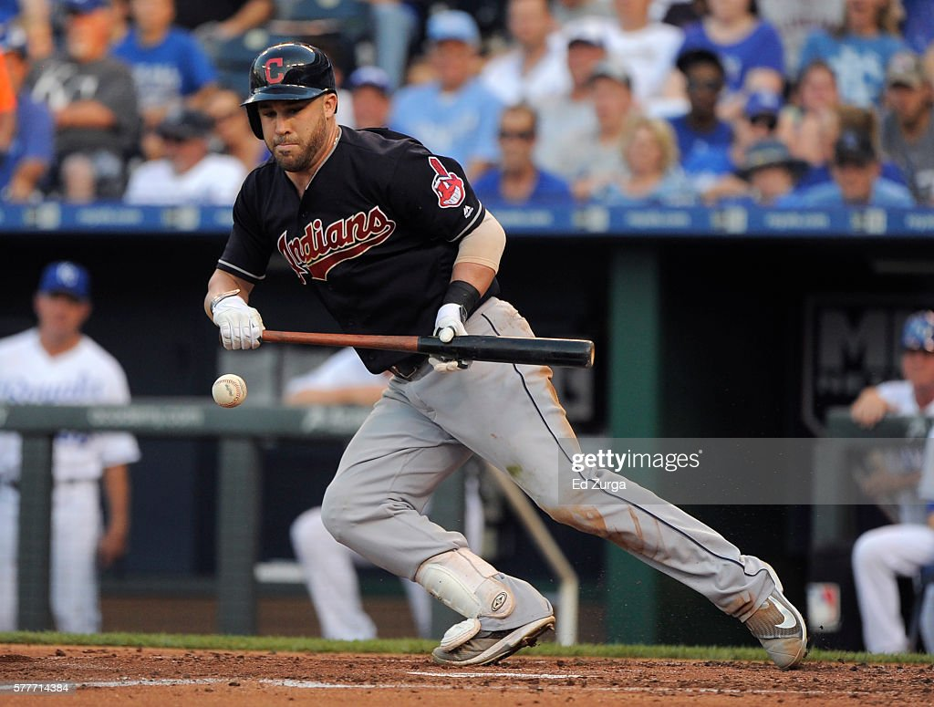 Jason Kipnis of the Cleveland Indians lays down a bunt in the third inning against the Kansas City Royals at Kauffman Stadium on July 19 2016 in...