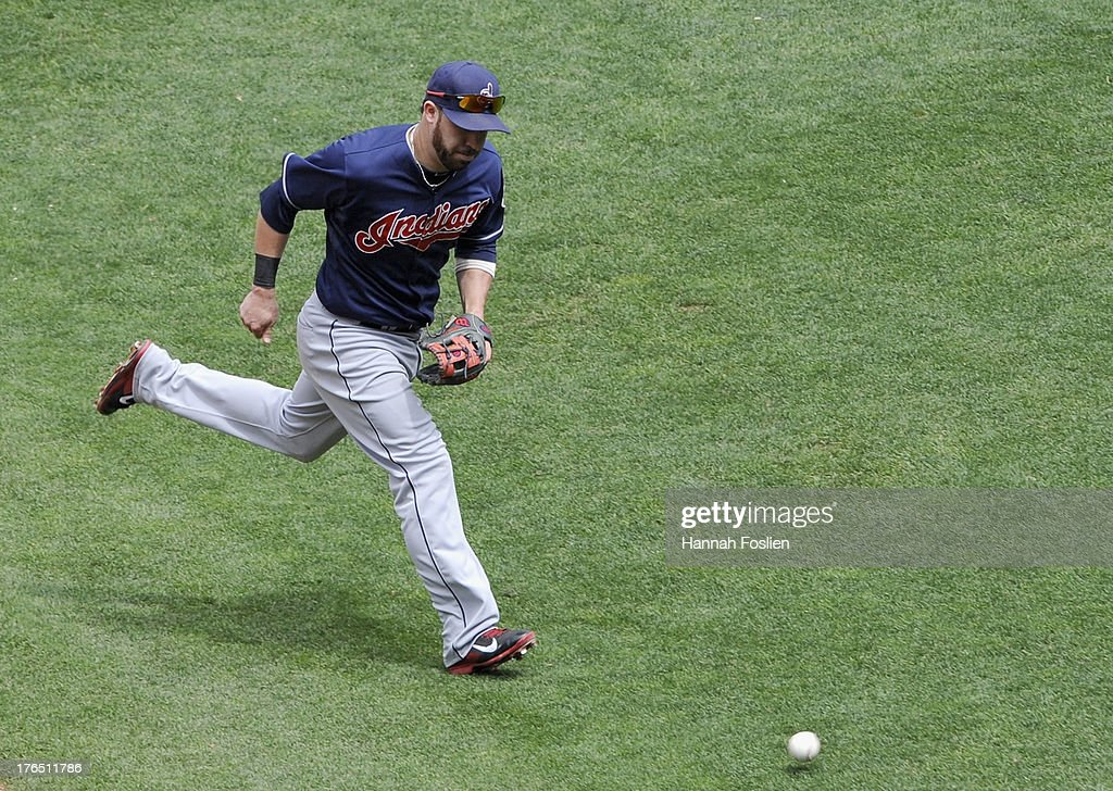 <a gi-track='captionPersonalityLinkClicked' href=/galleries/search?phrase=Jason+Kipnis&family=editorial&specificpeople=5330784 ng-click='$event.stopPropagation()'>Jason Kipnis</a> #22 of the Cleveland Indians looks on as the ball hit by Joe Mauer #7 of the Minnesota Twins gets past him during the sixth inning of the game on August 14, 2013 at Target Field in Minneapolis, Minnesota.