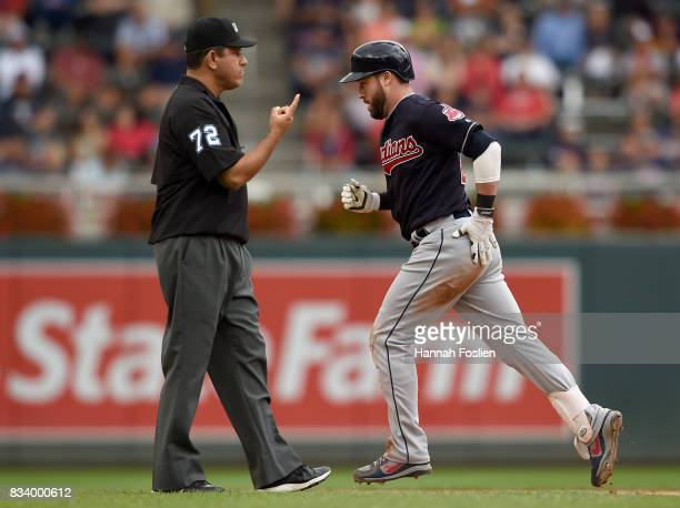 Jason Kipnis of the Cleveland Indians rounds the bases after hitting a solo home run as umpire Alfonso Marquez signals during the eighth inning in...
