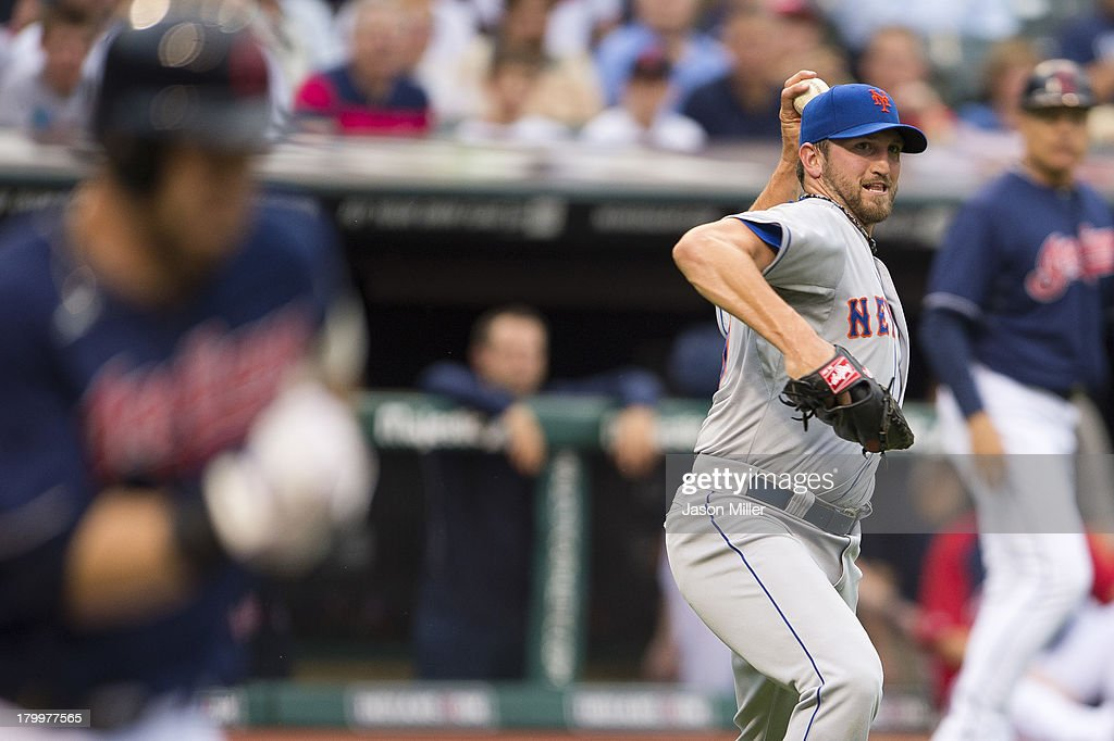 <a gi-track='captionPersonalityLinkClicked' href=/galleries/search?phrase=Jason+Kipnis&family=editorial&specificpeople=5330784 ng-click='$event.stopPropagation()'>Jason Kipnis</a> #22 of the Cleveland Indians runs out an infield hit as starting pitcher Jonathon Niese #49 of the New York Mets throws to first during the first inning at Progressive Field on September 7, 2013 in Cleveland, Ohio.