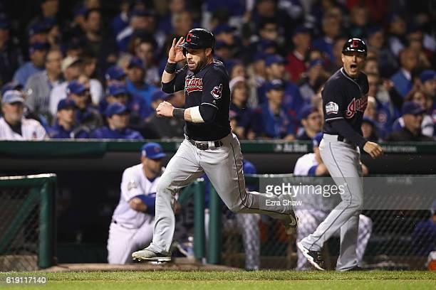 Jason Kipnis of the Cleveland Indians runs to home plate to score a run in the third inning against the Chicago Cubs in Game Four of the 2016 World...