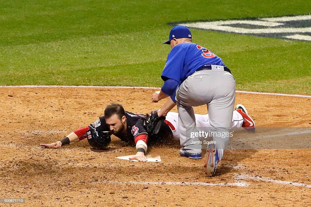 Jason Kipnis #22 of the Cleveland Indians scores a run on a wild pitch thrown by Jon Lester #34 of the Chicago Cubs during the fifth inning in Game Seven of the 2016 World Series at Progressive Field on November 2, 2016 in Cleveland, Ohio.