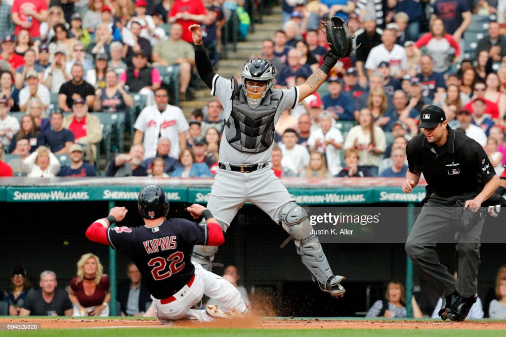 Jason Kipnis #22 of the Cleveland Indians scores on a RBI single in the first inning against Omar Narvaez #38 of the Chicago White Sox at Progressive Field on June 9, 2017 in Cleveland, Ohio.
