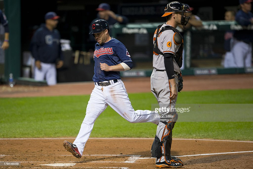 <a gi-track='captionPersonalityLinkClicked' href=/galleries/search?phrase=Jason+Kipnis&family=editorial&specificpeople=5330784 ng-click='$event.stopPropagation()'>Jason Kipnis</a> #22 of the Cleveland Indians scores on a sacrifice fly by Asdrubal Cabrera #13 during the fourth inning against the Baltimore Orioles at Progressive Field on September 3, 2013 in Cleveland, Ohio.
