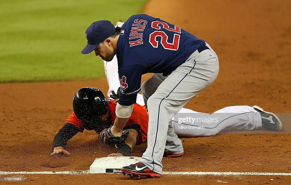 <a gi-track='captionPersonalityLinkClicked' href=/galleries/search?phrase=Jason+Kipnis&family=editorial&specificpeople=5330784 ng-click='$event.stopPropagation()'>Jason Kipnis</a> #22 of the Cleveland Indians tags out <a gi-track='captionPersonalityLinkClicked' href=/galleries/search?phrase=Jeff+Mathis&family=editorial&specificpeople=660661 ng-click='$event.stopPropagation()'>Jeff Mathis</a> #6 of the Miami Marlins during a game at Marlins Park on August 4, 2013 in Miami, Florida.