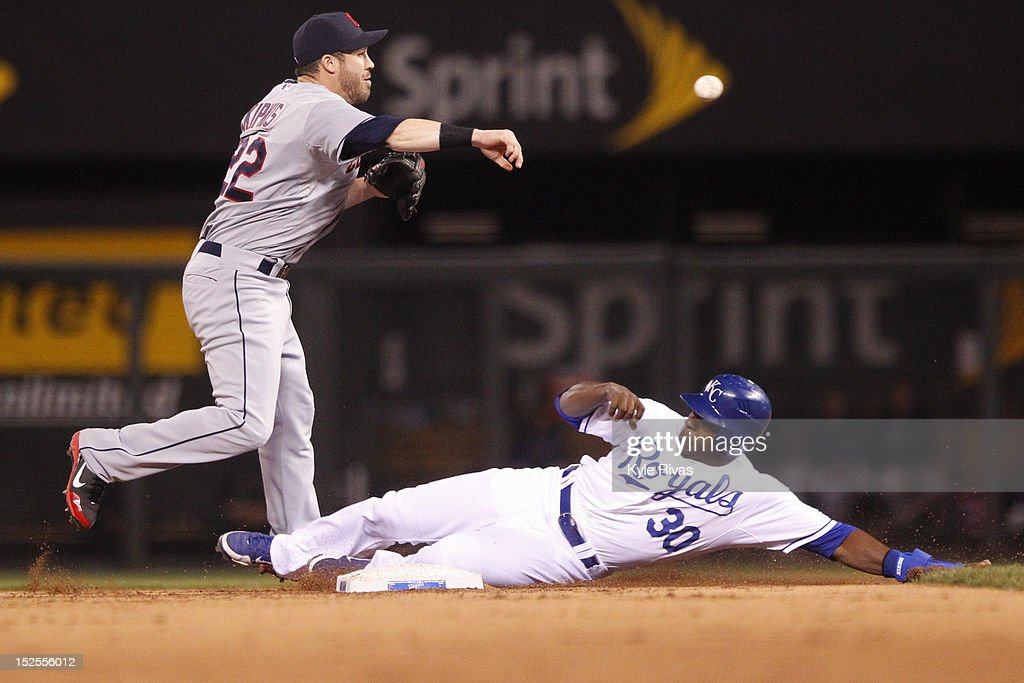<a gi-track='captionPersonalityLinkClicked' href=/galleries/search?phrase=Jason+Kipnis&family=editorial&specificpeople=5330784 ng-click='$event.stopPropagation()'>Jason Kipnis</a> #22 of the Cleveland Indians throws to first as <a gi-track='captionPersonalityLinkClicked' href=/galleries/search?phrase=Jason+Bourgeois&family=editorial&specificpeople=2495327 ng-click='$event.stopPropagation()'>Jason Bourgeois</a> #30 of the Kansas City Royals slides into second out in the eighth inning Friday, September 21, 2012 at Kauffman Stadium in Kansas City, Missouri.