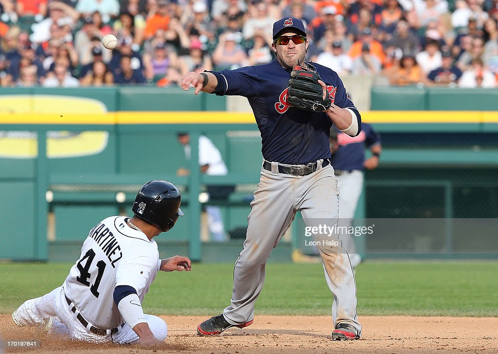 <a gi-track='captionPersonalityLinkClicked' href=/galleries/search?phrase=Jason+Kipnis&family=editorial&specificpeople=5330784 ng-click='$event.stopPropagation()'>Jason Kipnis</a> #22 of the Cleveland Indians turns the double play forcing out Victor Martinez #41 of the Detroit Tigers in the seventh inning of the game at Comerica Park on June 8, 2013 in Detroit, Michigan. The Tigers defeated the Indians 6-4.