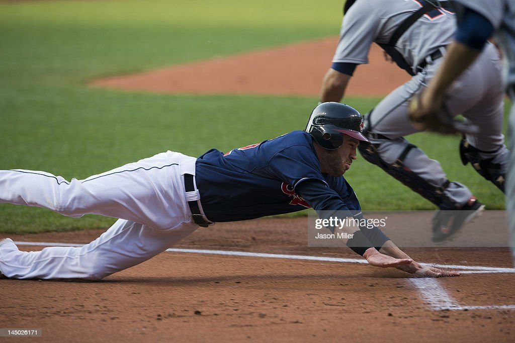 <a gi-track='captionPersonalityLinkClicked' href=/galleries/search?phrase=Jason+Kipnis&family=editorial&specificpeople=5330784 ng-click='$event.stopPropagation()'>Jason Kipnis</a> #22 scores on a double hit by Asdrubal Cabrera (not shown) #13 of the Cleveland Indians during the first inning against the Detroit Tigers at Progressive Field on May 22, 2012 in Cleveland, Ohio.