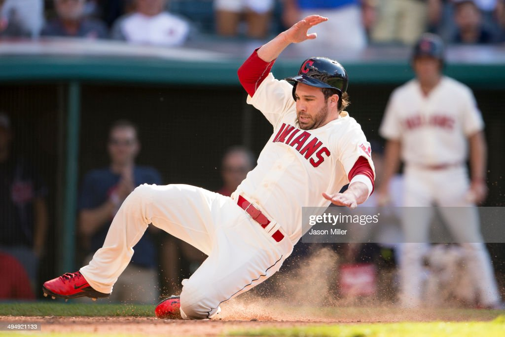 <a gi-track='captionPersonalityLinkClicked' href=/galleries/search?phrase=Jason+Kipnis&family=editorial&specificpeople=5330784 ng-click='$event.stopPropagation()'>Jason Kipnis</a> #22 scores the go-ahead run off a single by Mike Aviles #4 of the Cleveland Indians during the eighth inning against the Colorado Rockies at Progressive Field on May 31, 2014 in Cleveland, Ohio.