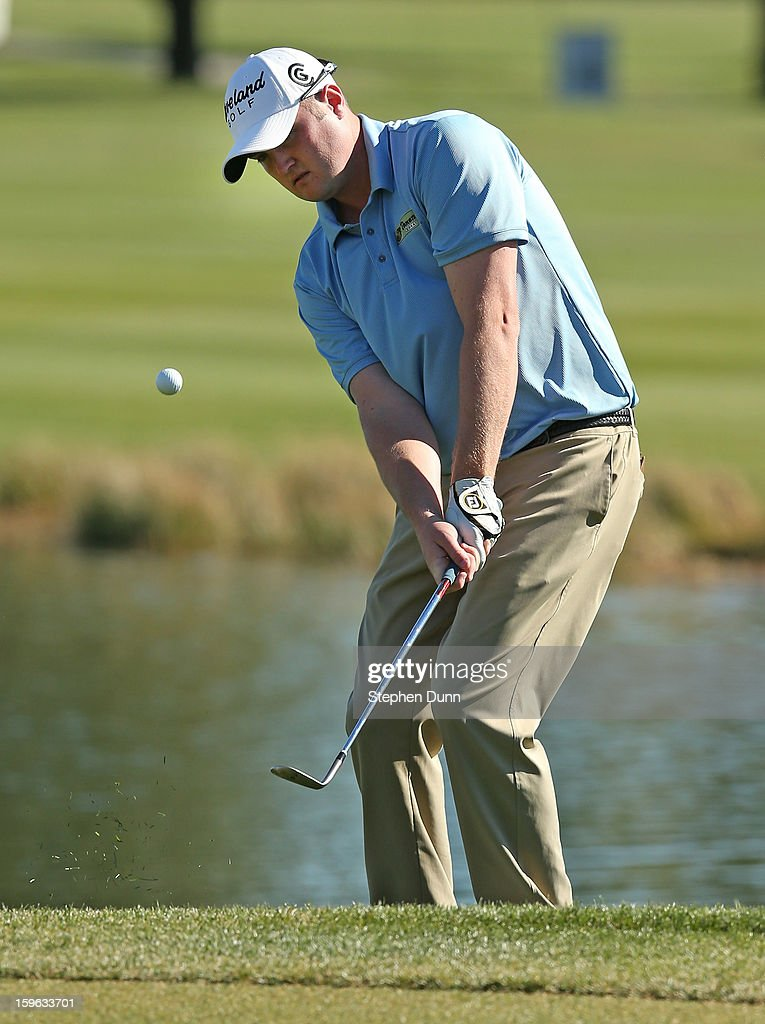 Jason Kokrak chips onto the green on the 18th hole during the first round of the Humana Challenge in partnership with the Clinton Foundation at La Quinta Country Club on January 17, 2013 in La Quinta, California.