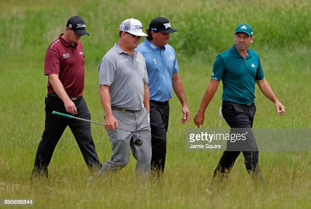 Jason Kokrak of the United States Charley Hoffman of the United States Pat Perez of the United States and Sergio Garcia of Spain walk along the first...