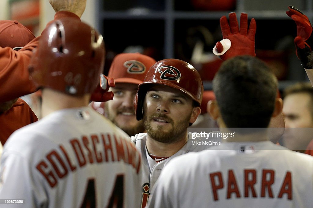 Jason Kubel #13 of the Arizona Diamondbacks celbrates in the dugout after hitting a two run homer in the top of the fourth inning scoring Paul Goldschmidt against the Milwaukee Brewers at Miller Park on April 6, 2013 in Milwaukee, Wisconsin.