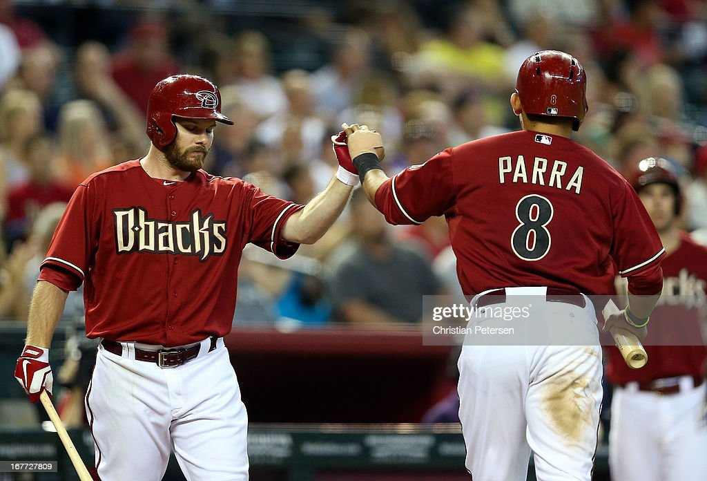 <a gi-track='captionPersonalityLinkClicked' href=/galleries/search?phrase=Jason+Kubel&family=editorial&specificpeople=575883 ng-click='$event.stopPropagation()'>Jason Kubel</a> #13 of the Arizona Diamondbacks high fives <a gi-track='captionPersonalityLinkClicked' href=/galleries/search?phrase=Gerardo+Parra&family=editorial&specificpeople=4959447 ng-click='$event.stopPropagation()'>Gerardo Parra</a> #8 after he scored a run against the Colorado Rockies during the fifth inning of the MLB game at Chase Field on April 28, 2013 in Phoenix, Arizona.