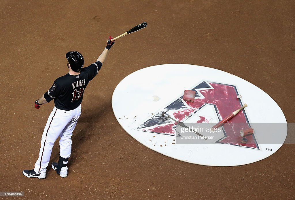<a gi-track='captionPersonalityLinkClicked' href=/galleries/search?phrase=Jason+Kubel&family=editorial&specificpeople=575883 ng-click='$event.stopPropagation()'>Jason Kubel</a> #13 of the Arizona Diamondbacks warms up on deck during the MLB game against the Milwaukee Brewers at Chase Field on July 14, 2013 in Phoenix, Arizona. The Brewers defeated the Diamondbacks 5-1.