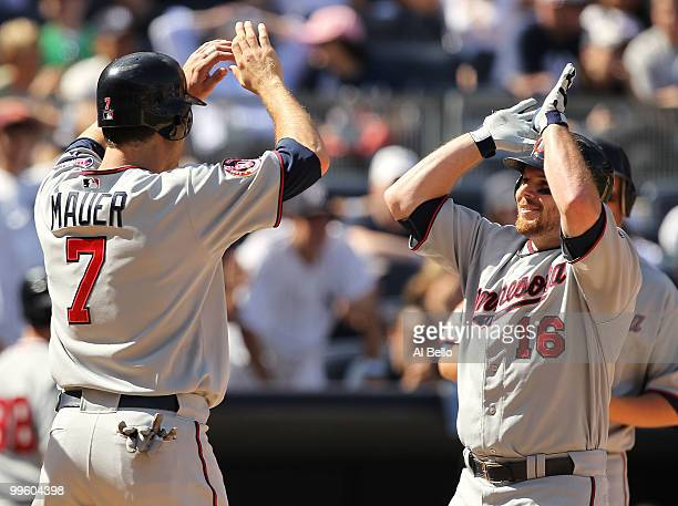 Jason Kubel of the Minnesota Twins is greeted by Joe Mauer after hitting a go ahead grand slam against Mariano Rivera of The New York Yankees in the...