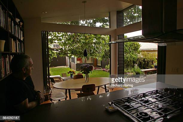 Jason La Padura looks out from the kitchen to the guesthouse in the backyard of his home that he shares with Gary Murphy Friday in Santa Monica July...
