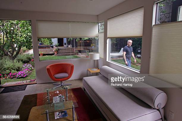 Jason La Padura makes his way past the guesthouse at his and Gary Murphy's home Friday in Santa Monica July 28 2006 It's about living small The 1000...