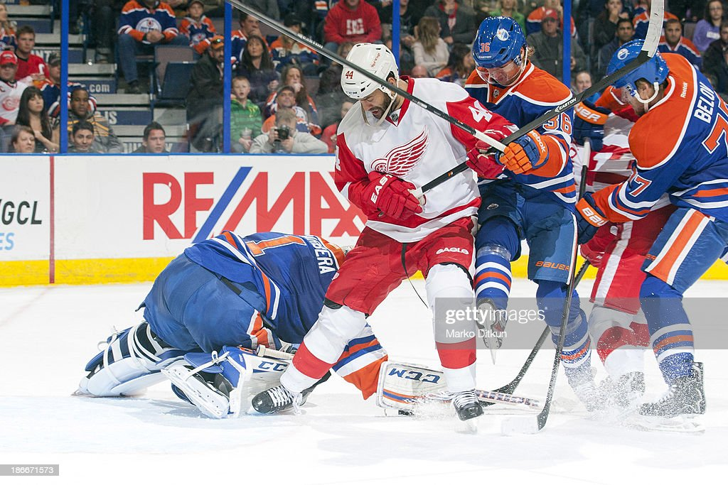 <a gi-track='captionPersonalityLinkClicked' href=/galleries/search?phrase=Jason+LaBarbera&family=editorial&specificpeople=240674 ng-click='$event.stopPropagation()'>Jason LaBarbera</a> #1 of the Edmonton Oilers makes a save as <a gi-track='captionPersonalityLinkClicked' href=/galleries/search?phrase=Todd+Bertuzzi&family=editorial&specificpeople=202476 ng-click='$event.stopPropagation()'>Todd Bertuzzi</a> #44 of the Detroit Red Wings crashes the net on November 2, 2013 at Rexall Place in Edmonton, Alberta, Canada.