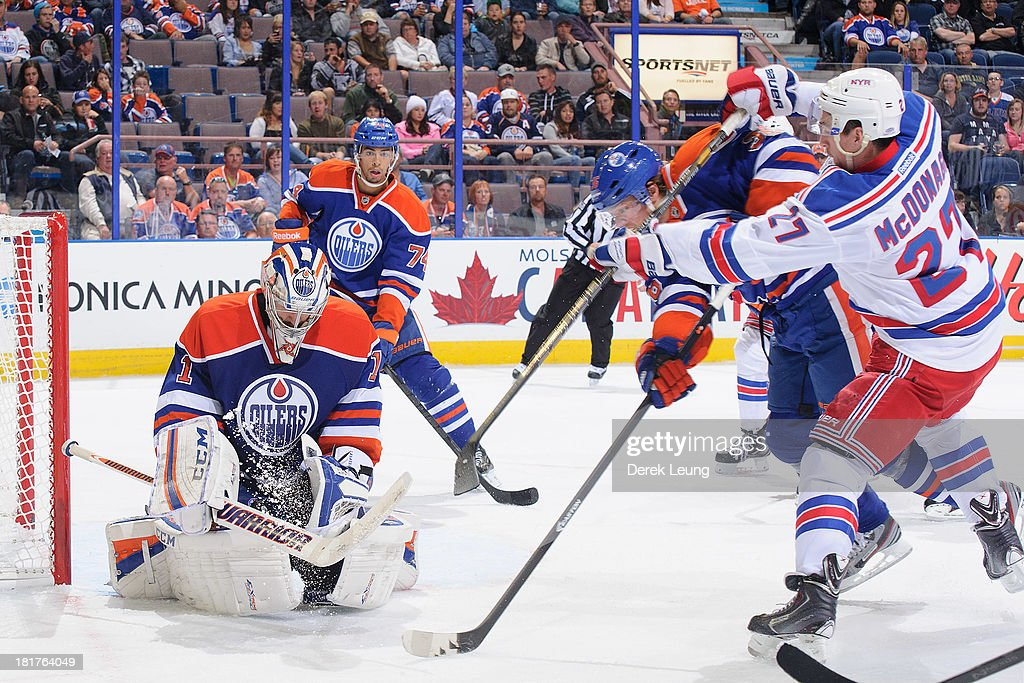 <a gi-track='captionPersonalityLinkClicked' href=/galleries/search?phrase=Jason+LaBarbera&family=editorial&specificpeople=240674 ng-click='$event.stopPropagation()'>Jason LaBarbera</a> #1 of the Edmonton Oilers stops the shot of <a gi-track='captionPersonalityLinkClicked' href=/galleries/search?phrase=Ryan+McDonagh&family=editorial&specificpeople=4324983 ng-click='$event.stopPropagation()'>Ryan McDonagh</a> #27 of the New York Rangers during a preseason NHL game at Rexall Place on September 24, 2013 in Edmonton, Alberta, Canada.