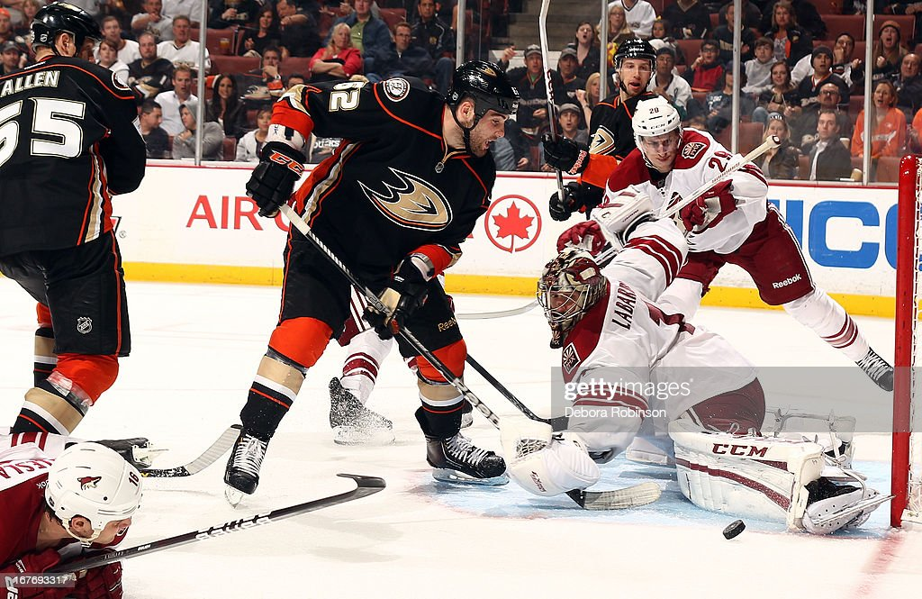 <a gi-track='captionPersonalityLinkClicked' href=/galleries/search?phrase=Jason+LaBarbera&family=editorial&specificpeople=240674 ng-click='$event.stopPropagation()'>Jason LaBarbera</a> #1 of the Phoenix Coyotes defends the goal as <a gi-track='captionPersonalityLinkClicked' href=/galleries/search?phrase=Patrick+Maroon&family=editorial&specificpeople=4589240 ng-click='$event.stopPropagation()'>Patrick Maroon</a> #62 of the Anaheim Ducks attempts a goal during the game on April 27, 2013 at Honda Center in Anaheim, California.