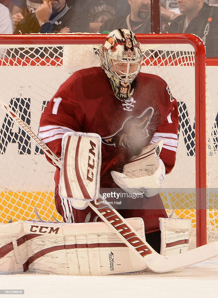 <a gi-track='captionPersonalityLinkClicked' href=/galleries/search?phrase=Jason+LaBarbera&family=editorial&specificpeople=240674 ng-click='$event.stopPropagation()'>Jason LaBarbera</a> #1 of the Phoenix Coyotes stops a shot against the Vancouver Canucks at Jobing.com Arena on March 21, 2013 in Glendale, Arizona.