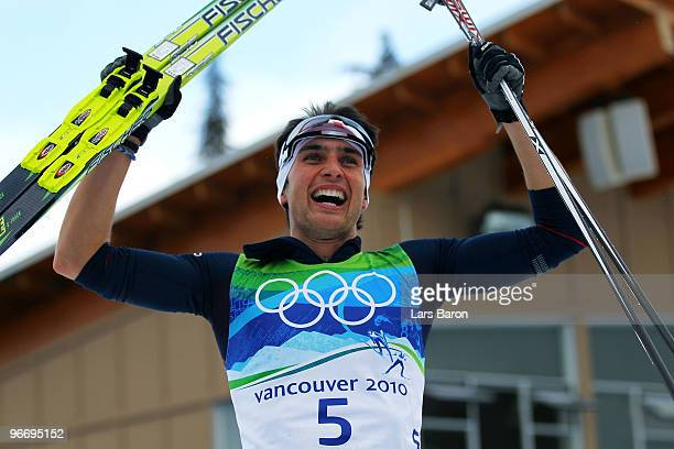 Jason Lamy Chappuis of France celebrates after he won the Gold Medal during the Nordic Combined Men's Individual 10km on day 3 of the 2010 Winter...