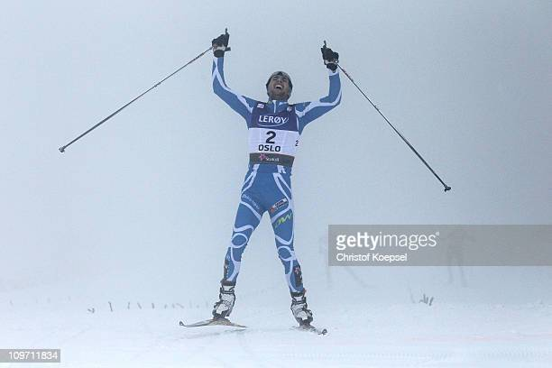 Jason Lamy Chappuis of France celebrates as he crosses the finish line to win the gold medal in the Nordic Combined Cross Country 10km race during...