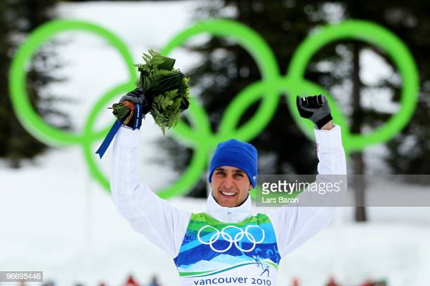 Jason Lamy Chappuis of France celebrates on the podium after he won the Gold Medal during the Nordic Combined Men's Individual 10km on day 3 of the...