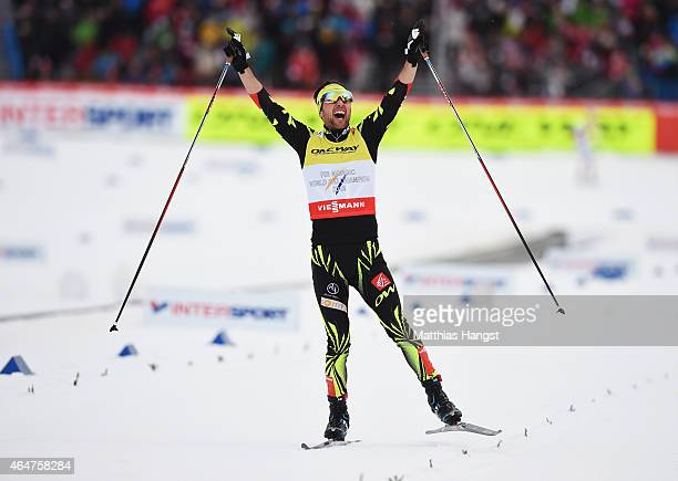Jason Lamy Chappuis of France celebrates winning the gold medal in the Men's Team Nordic Combined during the FIS Nordic World Ski Championships at...