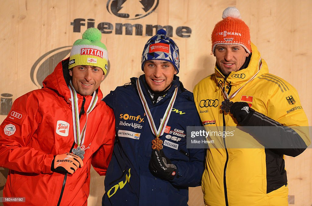 Jason Lamy Chappuis of France celebrates with his Gold medal, Mario Stecher of Austria (L) his Silver medal and Bjoern Kircheisen of German (R) his Bronze medal at the medal ceremony for the Men's Nordic Combined 106+10km at the FIS Nordic World Ski Championships on February 23, 2013 in Val di Fiemme, Italy.