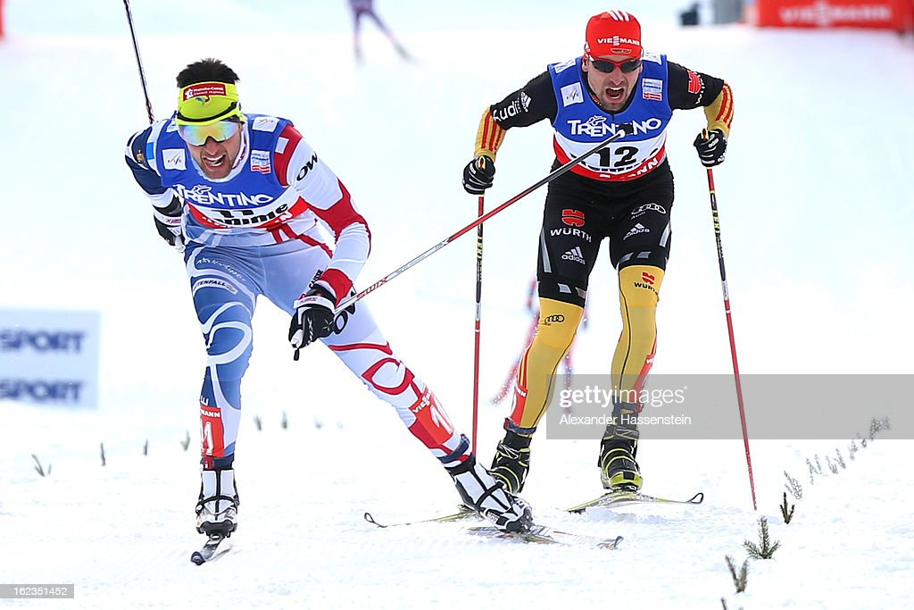 Jason Lamy Chappuis (L) of France crosses the finish line ahead of <a gi-track='captionPersonalityLinkClicked' href=/galleries/search?phrase=Bjoern+Kircheisen&family=editorial&specificpeople=726172 ng-click='$event.stopPropagation()'>Bjoern Kircheisen</a> (R) of Germany, who wons the 3rd place of the Men's Nordic Combined on February 22, 2013 in Val di Fiemme, Italy.