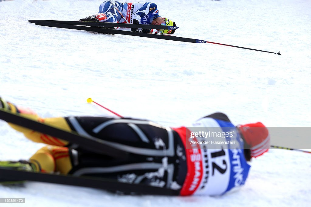 Jason Lamy Chappuis (top) of France crosses the finish line ahead of Bjoern Kircheisen (botton) of Germany, who wons the 3rd place of the Men's Nordic Combined on February 22, 2013 in Val di Fiemme, Italy.