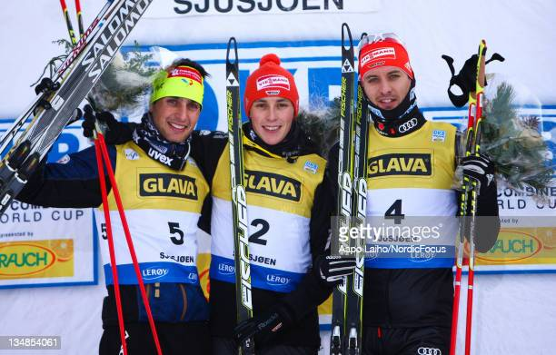 Jason Lamy Chappuis of France Eric Frenzel of Germany and Bjoern Kircheisen of Germany celebrate on the podium after the Men's Nordic Combined...