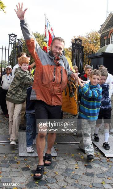 Jason Lewis finishes his human powered around the world trip at the Greenwich Meridian in Greenwich London