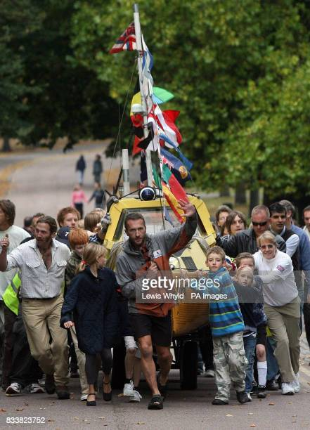 Jason Lewis pulls his boat after he finished his human powered around the world trip at the Greenwich Meridian in Greenwich London