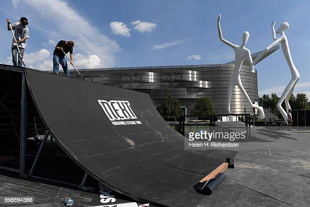 Jason Lorenz left and Alex Bingham use rollers to paint platforms for the BMX and skateboard structures to be used for the upcoming FISE Sculpture...