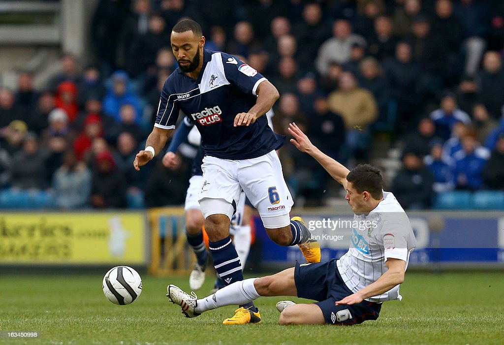 Jason Lowe of Blackburn Rovers slides in for a tackle on Liam Trotter of Millwall during the FA Cup sponsored by Budweiser sixth round match between Millwall and Blackburn Rovers at The Den on March 10, 2013 in London, England.